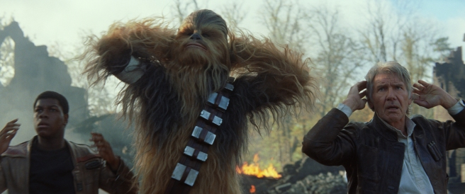 Star Wars: The Force Awakens L to R: Finn (John Boyega), Chewbacca (Peter Mayhew), and Han Solo (Harrison Ford) Ph: Film Frame © 2014 Lucasfilm Ltd. & TM. All Right Reserved..